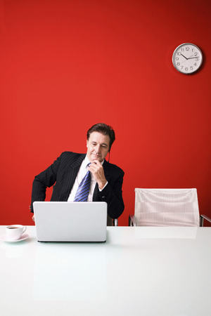 conferencing: Businessman video conferencing on laptop Stock Photo