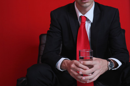 Businessman with a glass of water photo