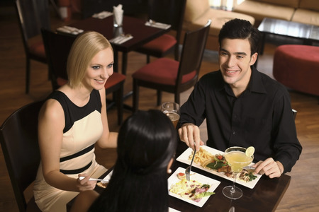 Man and women having dinner together photo