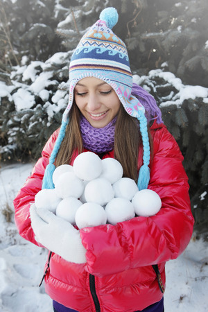 armful: Woman with an armful of snowballs