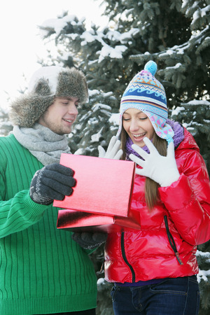 Man giving woman a surprise gift photo
