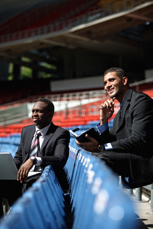 south western european descent: Businessmen in the stadium Stock Photo