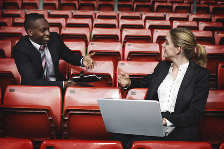 afro arab: Business people having discussion in a stadium