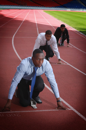 afro arab: Business people crouching on starting line