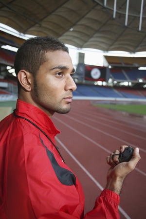 Sports coach with stopwatch photo