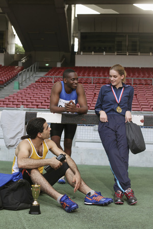 afro arab: Athletes resting and chatting after the competition Stock Photo
