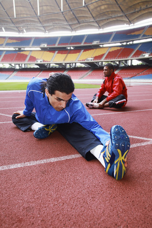 south western european descent: Athletes warming up on running track