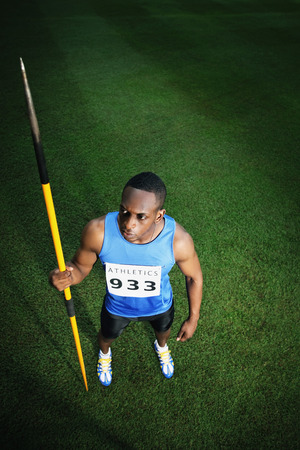 afro arab: Male athlete holding javelin