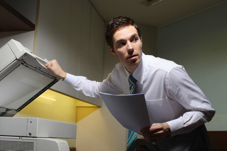 Businessman secretly copying documents