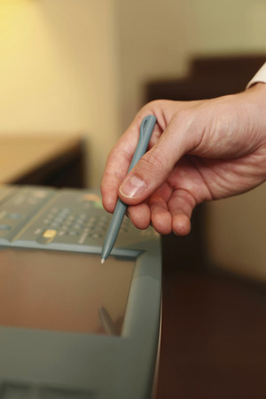 photocopier: Businessman using photocopier Stock Photo