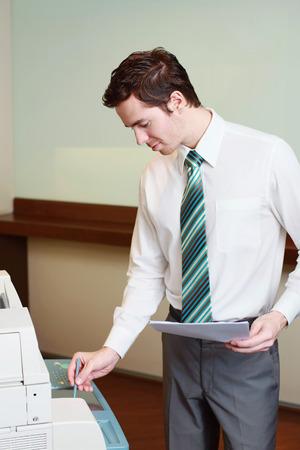 Businessman using photocopier Stock Photo