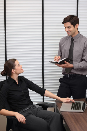 central european ethnicity: Businessman and businesswoman having discussion Stock Photo