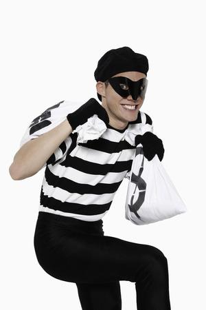 sneaking: Burglar sneaking away with bags of money