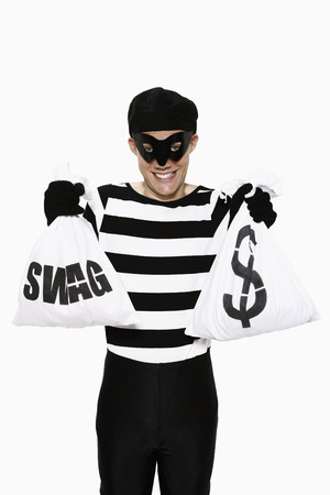 Burglar with his stolen goods Stock Photo