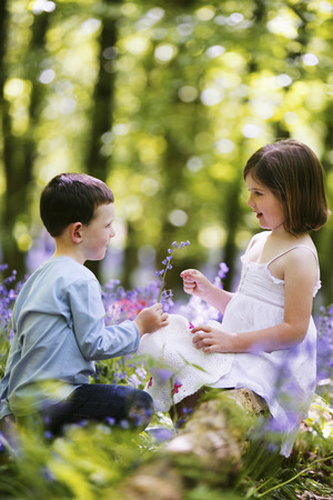 Boy giving girl flower photo