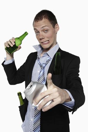 Drunken businessman holding beer bottle and pointing