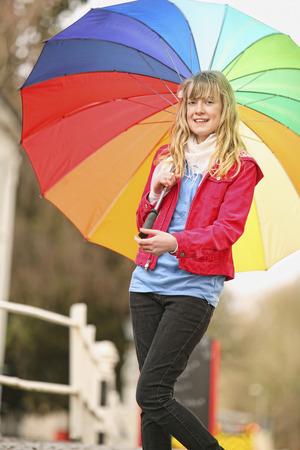 Girl holding a colorful umbrella photo