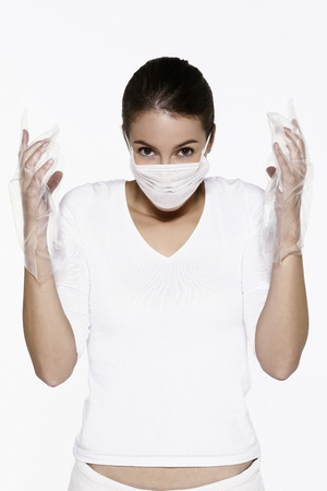 Woman with surgical mask and plastic gloves photo
