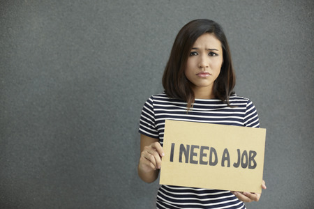 demotivated: Woman holding a placard Stock Photo