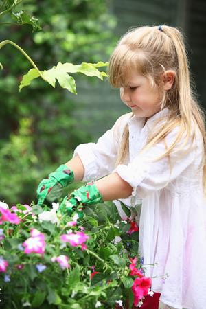 tending: Girl tending to garden Stock Photo
