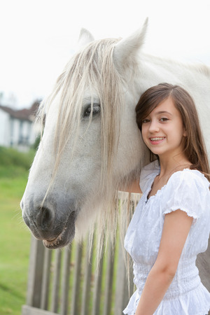 petting: Girl petting horse outdoors Stock Photo