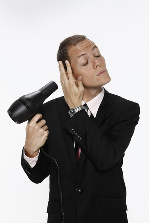 hairdryer: Businessman blowing hair with hairdryer