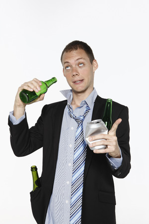 beer and necktie: Drunken businessman with beer bottles Stock Photo