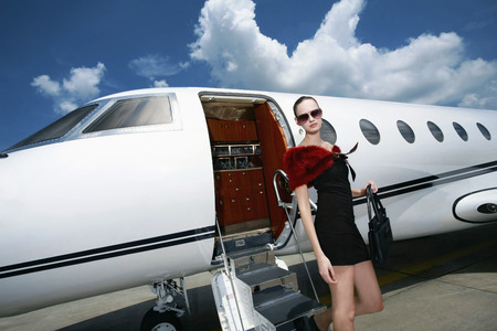 Woman exiting private jet photo