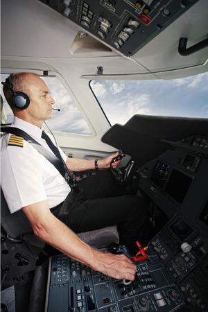 Pilot in private jet cockpit