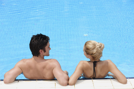 Man and woman relaxing in the pool photo