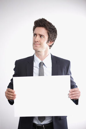 Businessman with a blank placard Stock Photo - 26391637