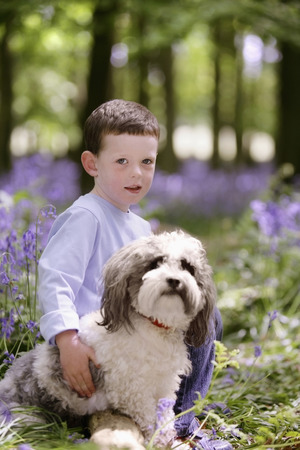 Boy and his pet dog photo