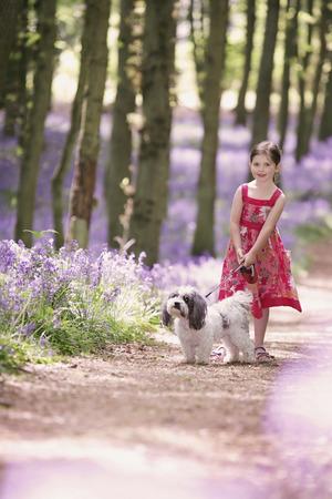 Girl walking her dog photo