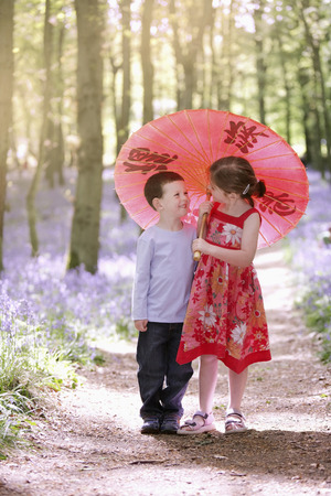 Boy and girl sharing an umbrella photo