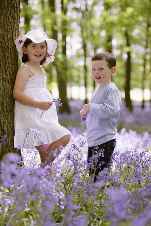 Boy and girl in field of flowers photo