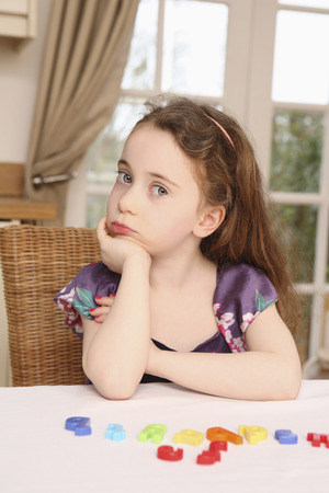 sulking: Girl sitting on a chair, sulking