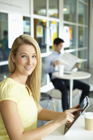 Businesswoman using digital tablet photo