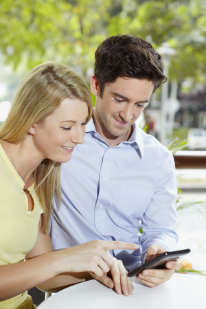 Man and woman reading text message photo