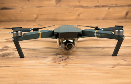 DJI Mavic Pro drone: Riga,Latvia DECEMBER 25,2016. One of the first DJI Mavic Pro drones shipped to Europe. Closeup,on wooden background. One of the most portable drones in the market,with 4k ultra hd