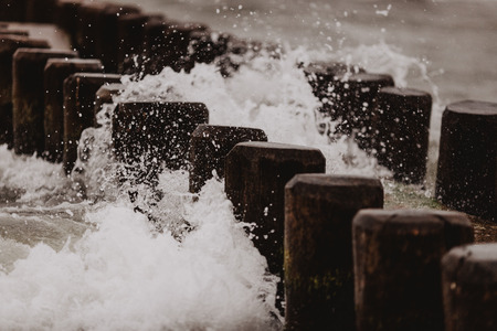 breakwater - groyne at stormy day in germany, baltic sea Imagens