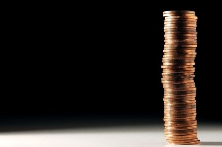 long stack of golden coins Stock Photo
