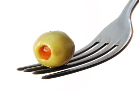 olive in fork on white background Standard-Bild
