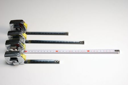 Measuring tapes over a light background from above Standard-Bild