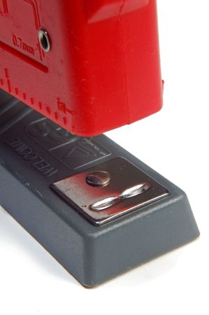 red stapler closeup on white background photo