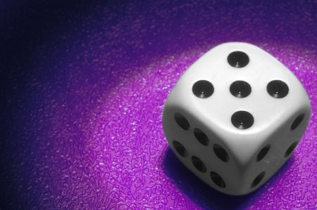 die with spot light on purple background