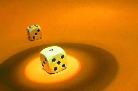 die with spot light on orange background Stock Photo