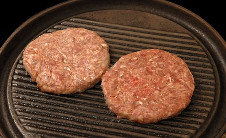 two raw burgers