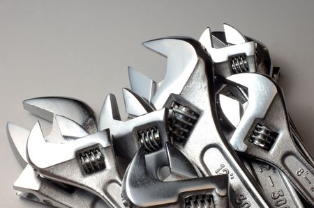 adjustable wrenchs heads on light background photo