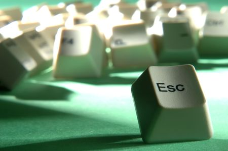 esc: esc key escaping from crowd of keyboard keys Stock Photo