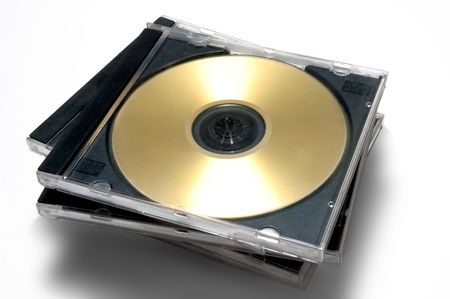 Stack of classic CDDVD case with golden disc Stock Photo